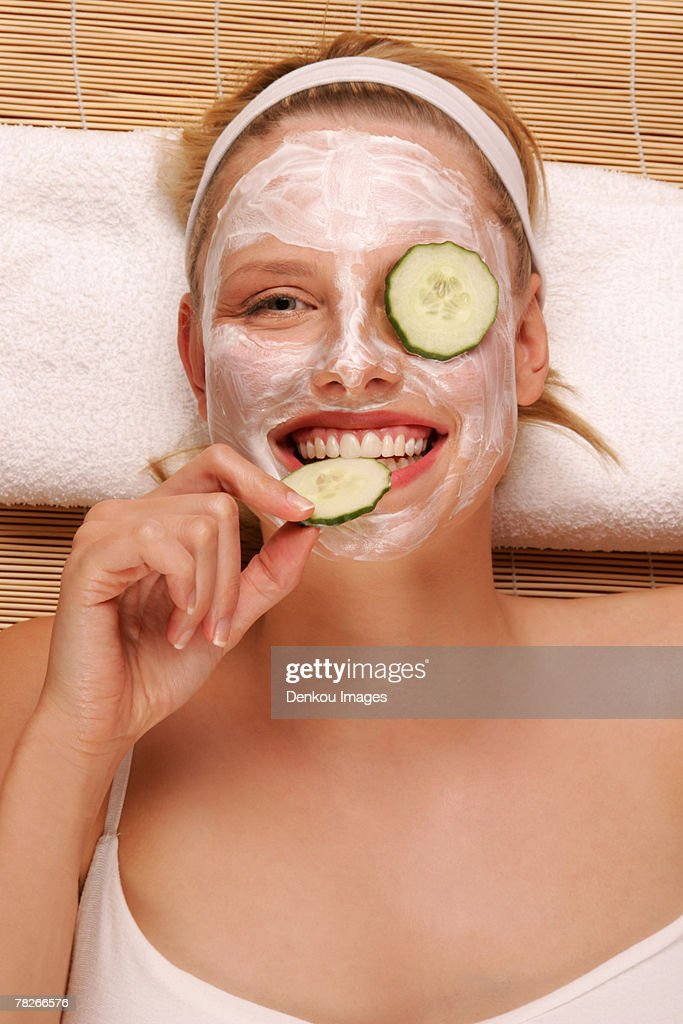 A young woman with a face pack. : Stock Photo