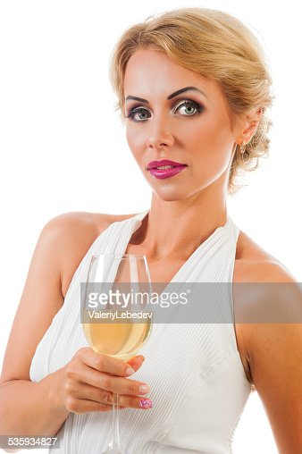 Young woman with a glass of champagne : Stock Photo