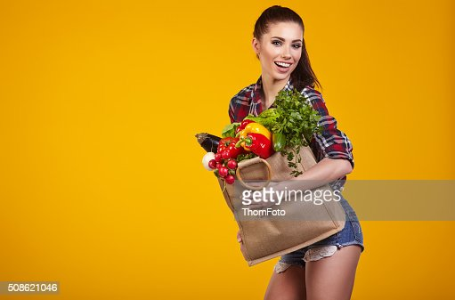 Young woman with a grocery shopping bag. : Stock Photo