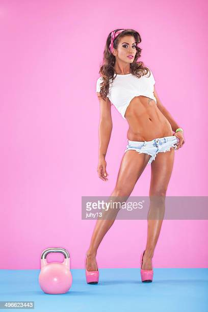 Young woman with a kettlebell