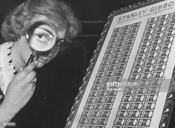 A young woman with a magnifying glass beside stamps to celebrate National Productivity Year at the National Stamp Exhibition The stamps on the right...