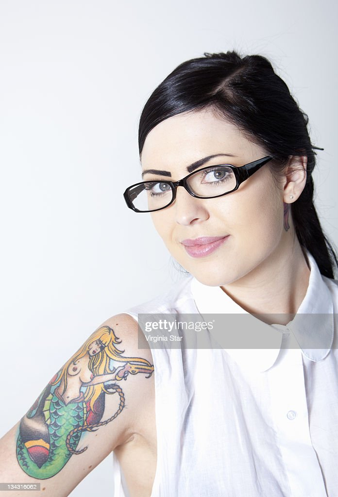 A Young Woman With A Tattoo & Spectacles : Stock Photo