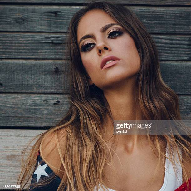 Young woman with American flag.