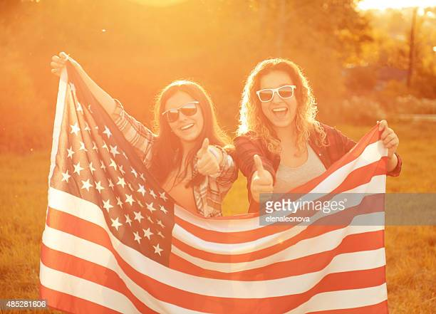 young woman with an American flag