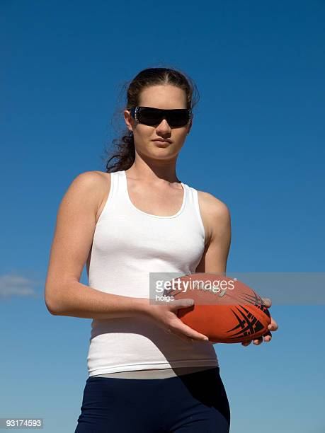 Young woman with an Australian Rules Football