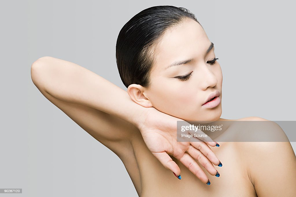 Young woman with arm raised : Stock Photo