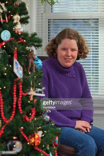 Young woman with Autism enjoying Christmas tree