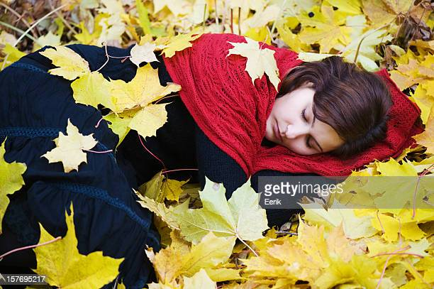 Young woman with autumn leaves