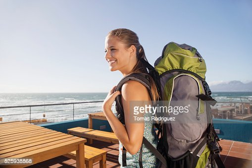 Young woman with backpack : Stock Photo