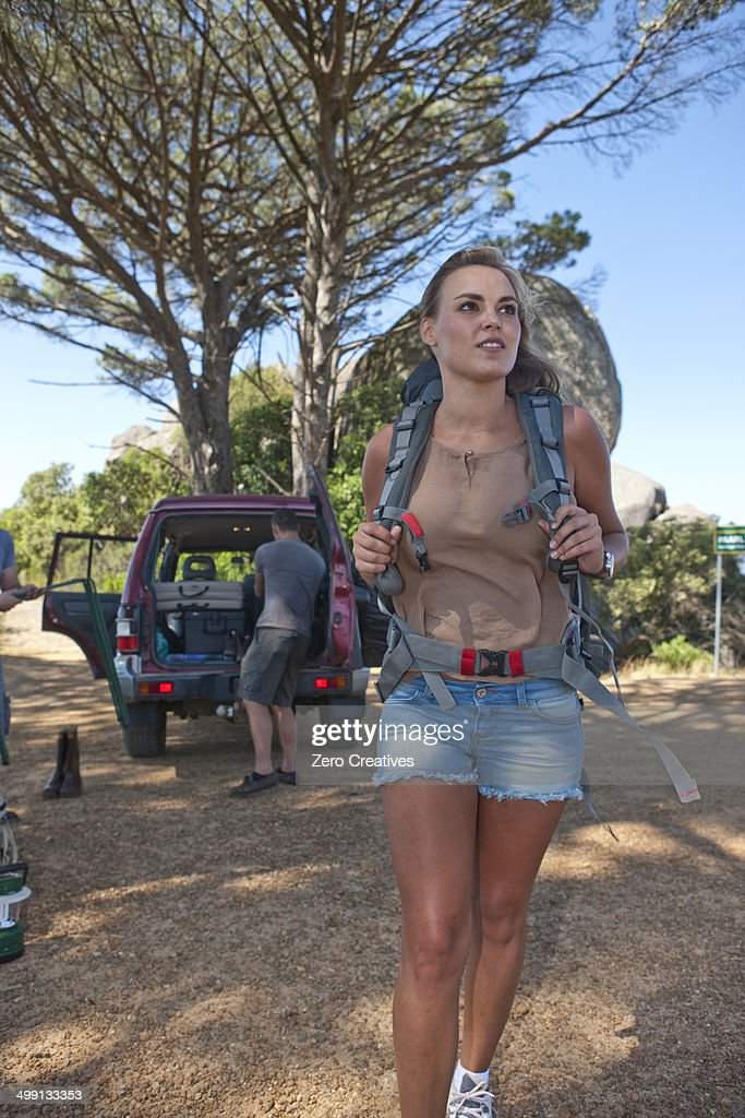 Young woman with backpack setting off to hike