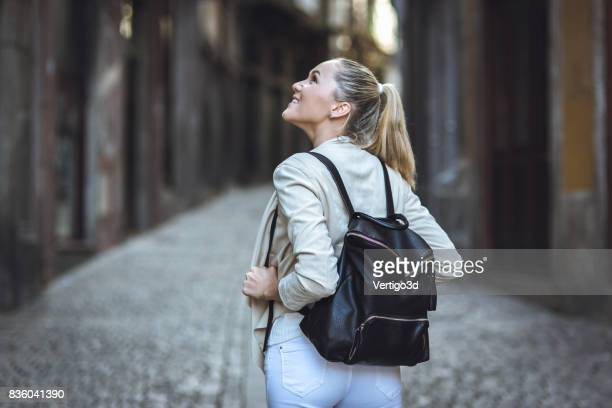 Young woman with backpack walking on the european streets