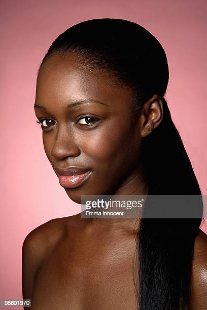 Young woman with bare shoulders and ponytail
