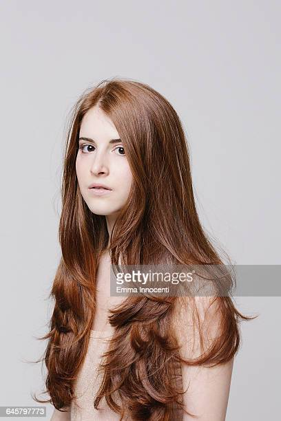 Young woman with beautiful red hair