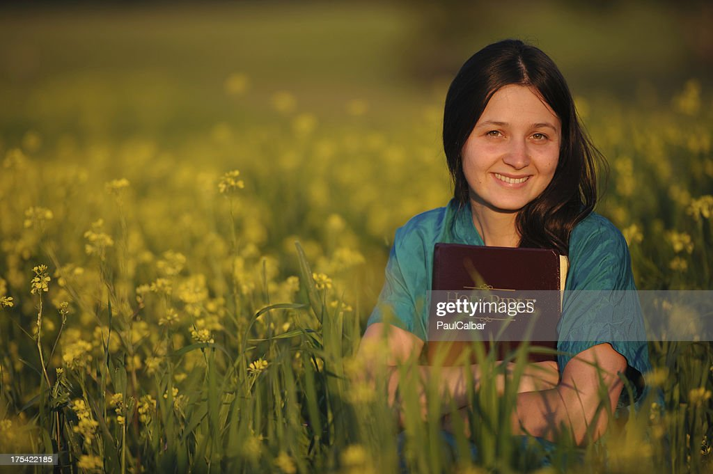 Young woman with bible