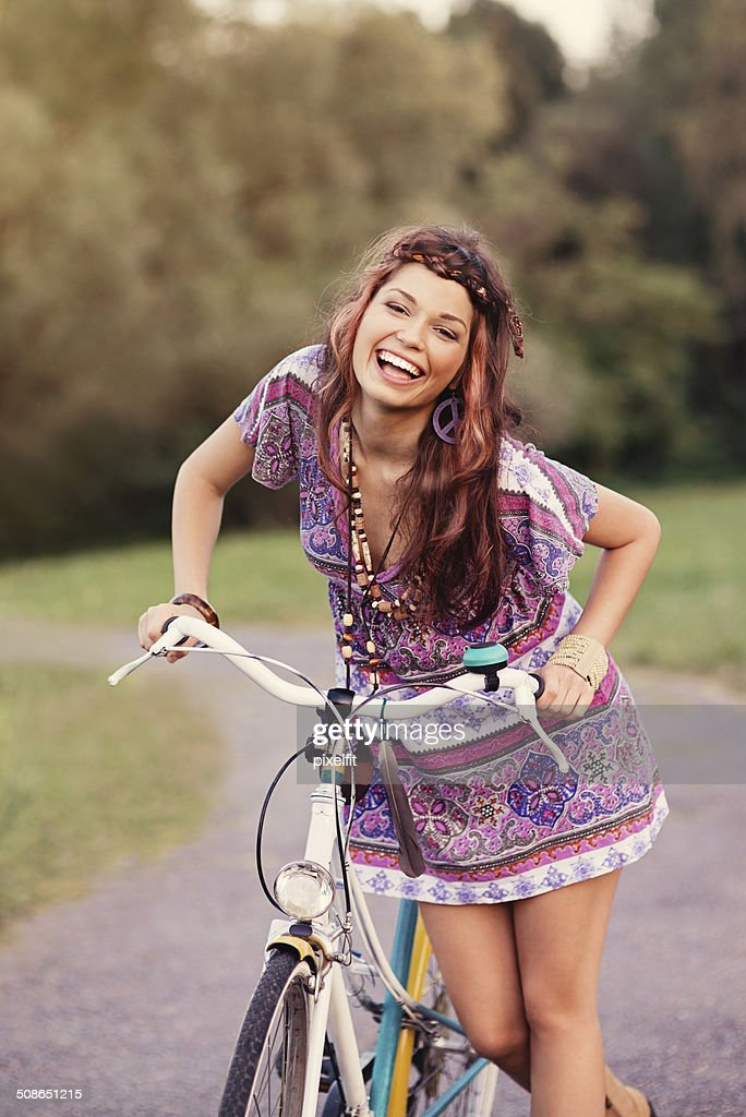 Young woman with bicycle in a park : Stock Photo