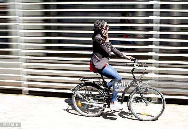 Young woman with bicycle on the street