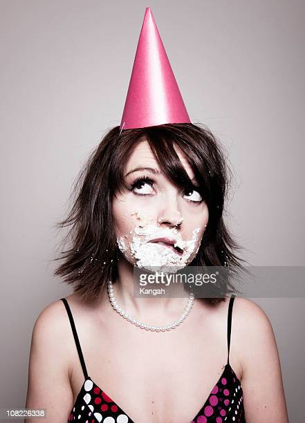 Young Woman With Birthday Cake on Face