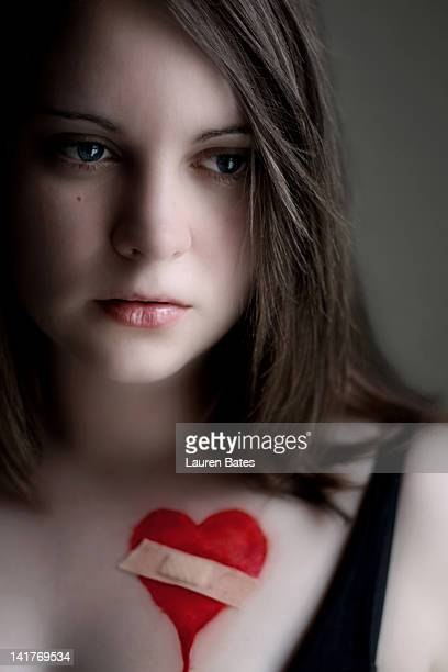 Young woman with bleeding heart