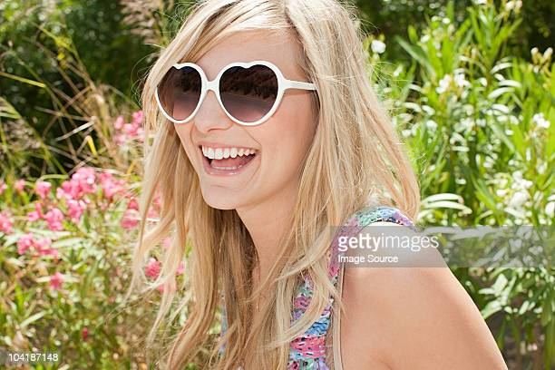 Young woman with blond hair wearing sunglasses
