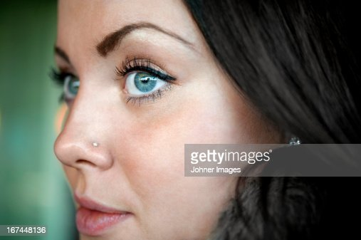 Young woman with blue eyes looking away : Stock Photo