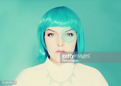 Young woman with blue hair and pulse from her eye : Stock Photo