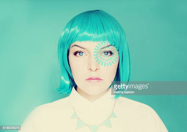 Young woman with blue hair and pulse from her eye