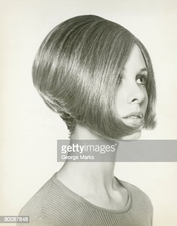Young woman with bob hairstyle, close-up, studio shot
