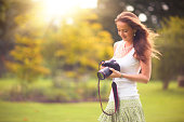Young woman with camera In the sunlight
