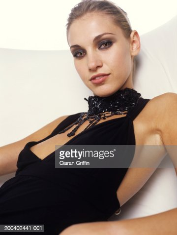 Young woman with cat's eye contact lens and choker, close up, portrait : Stock Photo