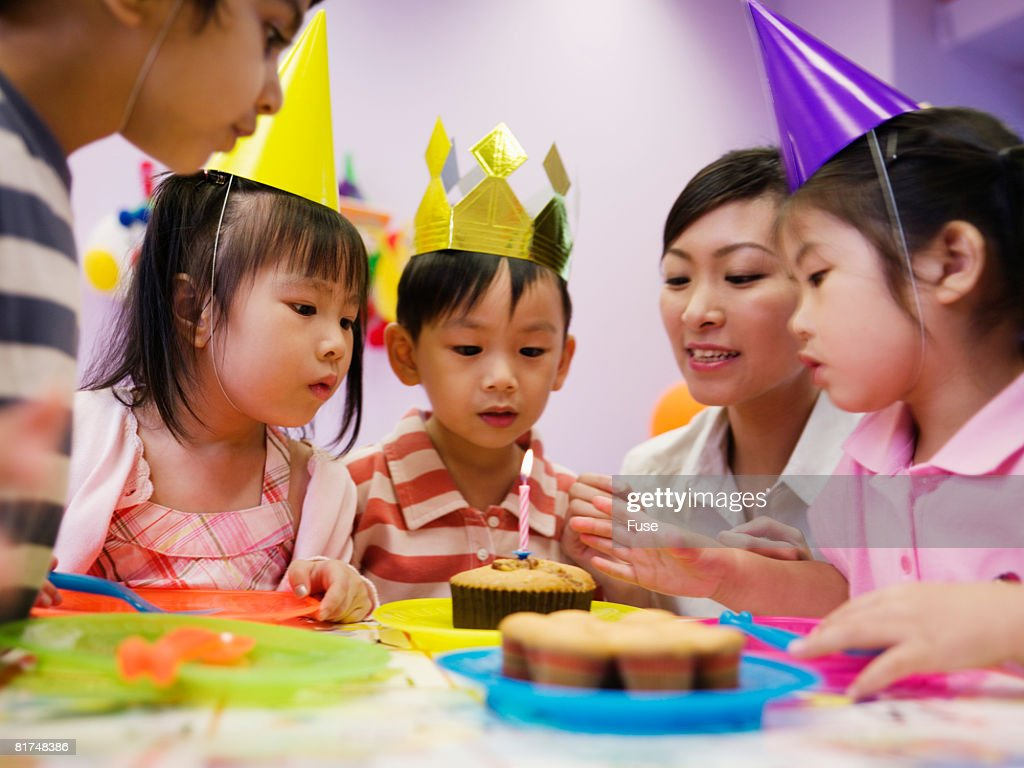Young Woman with Children During Birthday Party : Stock Photo