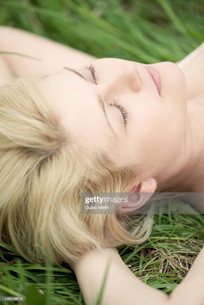 Young woman with closed eyes outdoor. : Stock Photo