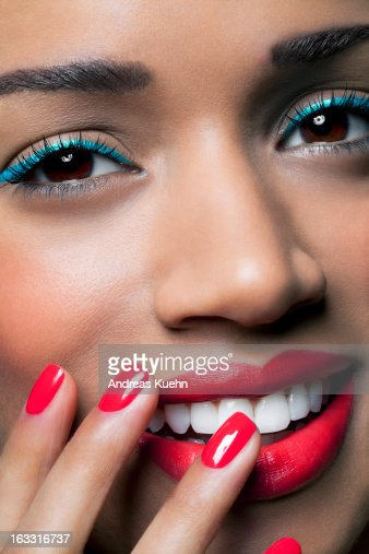 Young woman with colorful make up and nails. : Bildbanksbilder