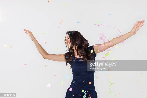 young woman with confetti flying