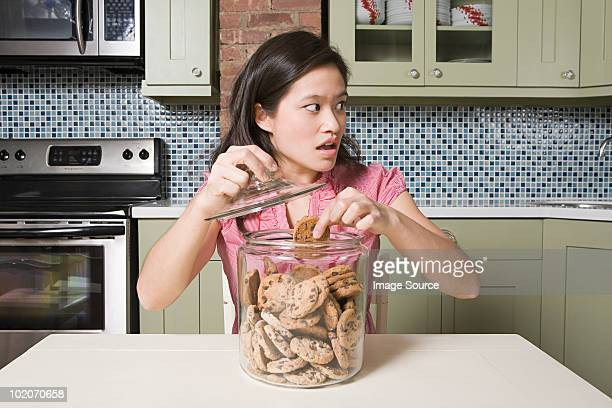 Young woman with cookie jar