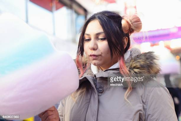 Young woman with cotton candy