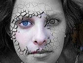 OLYMPUS DIGITAL CAMERA         Beauty and health concept - face covered with cracked surface - symbol of dry skin and stress