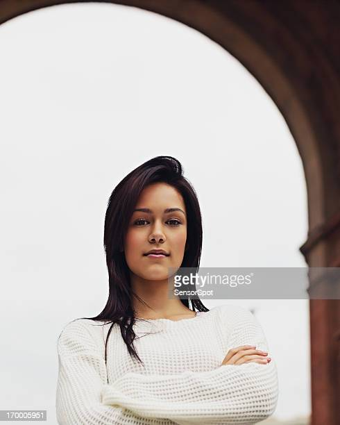 Young woman with crossed arms