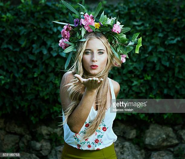 Young woman with crown of flowers on head