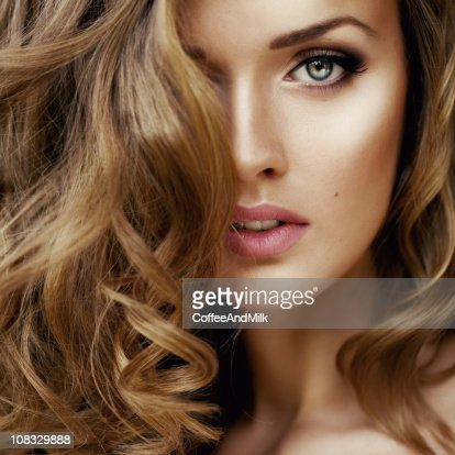 Young woman with curly hair : Stock Photo