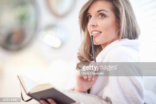 Young woman with diary and pen : Stock Photo