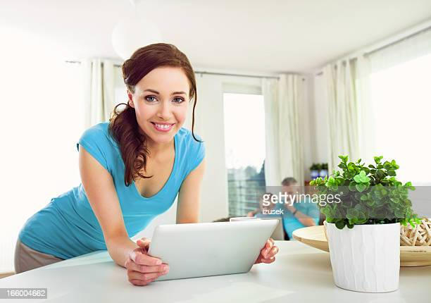 Young Woman with Digital Tablet at Home