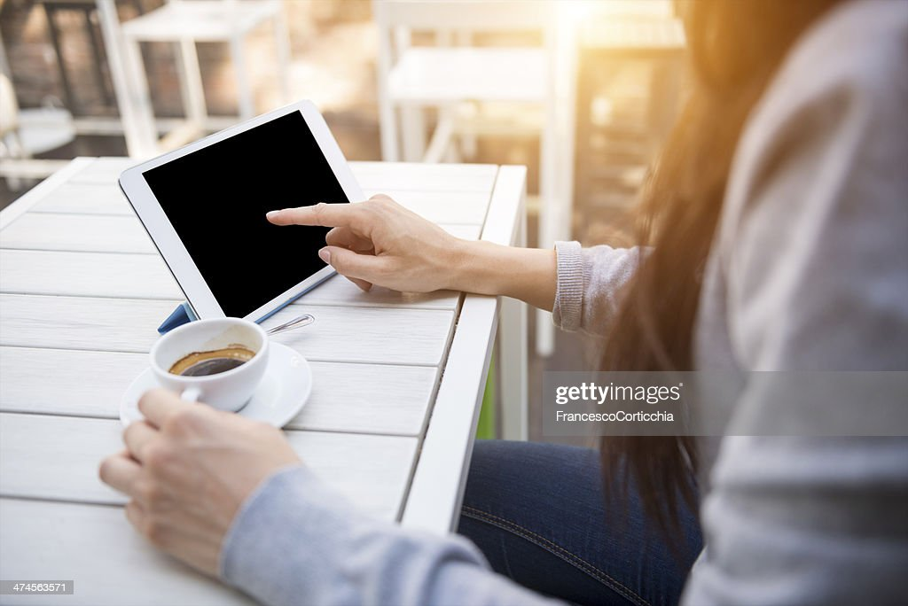 Young woman with digital tablet at the cafè : Stock Photo