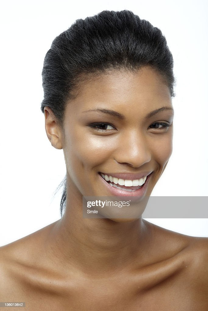 Young woman with dimples smiling : Stock Photo