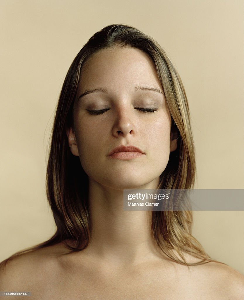 Young woman with eyes closed, close-up : Stock Photo