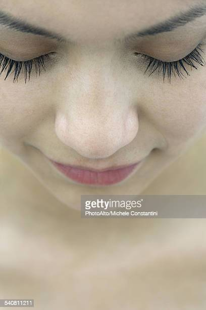Young woman with eyes closed, close-up