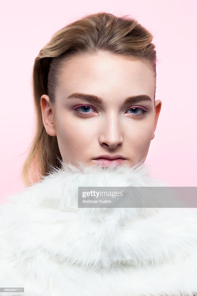 Young woman with fake fur around her neck.