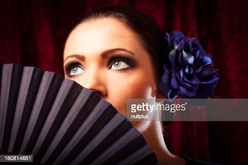 young woman with fan : Stock Photo