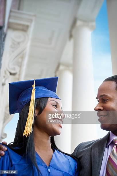 Young Woman with Father at College Graduation