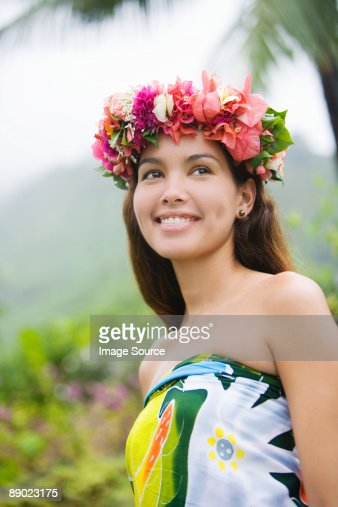 Young woman with flowers in hair in moorea : Stock Photo