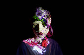 Young Woman with Flowers Projected on to Her